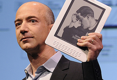 Amazon.com Founder and CEO, Jeff Bezos, holding a Kindle.