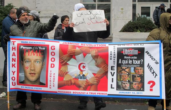 Facebook's CEO Mark Zuckerberg On Tunisian Protest Sign