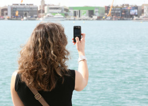 Woman taking a photo with her mobile phone